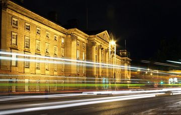 Thumb_trinity_college_exterior_night_istock
